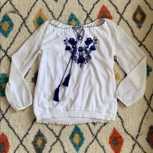 White long sleeve shirt with blue embroidery